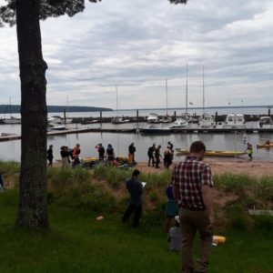 people gathering on shore of lake superior