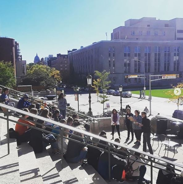 Students sit on steps outside Memorial Library